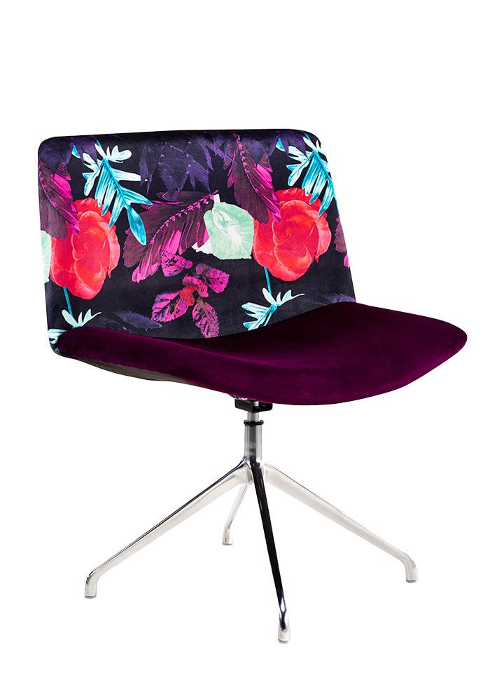 The Amy tub chair with velvet and floral upholstery.